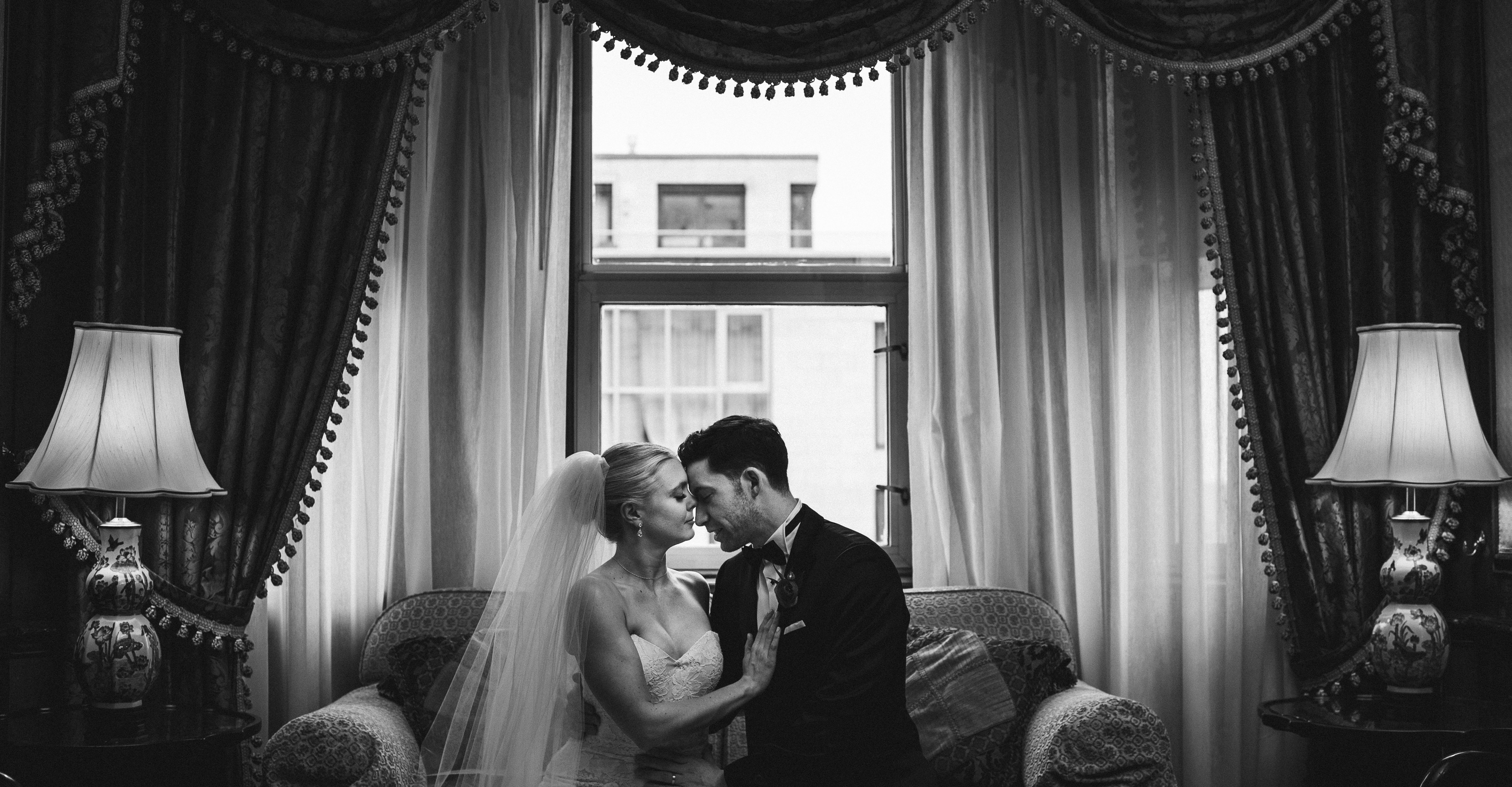 wedding photographer takes picture of couple at the Chateau Laurier in Ottawa